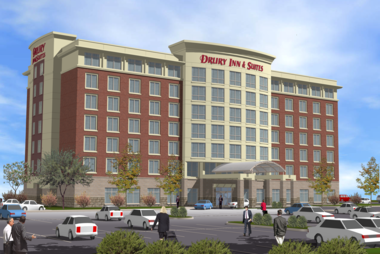 A sketch shows what the proposed Cascade Township Drury Inn and Suites would look like.