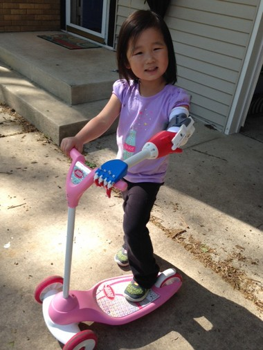 Maeli Gottschalk shows off her new arm and her scooter.