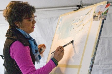 Pamela Alderman painted in front of a live audience at the annual Arts in Ada event May 14. Her painting was commissioned by the Ada Arts Council and will hang at the township hall.