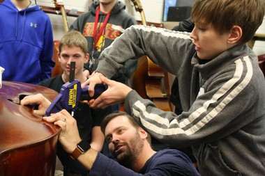 """NorthPointe has implemented many """"real world"""" learning experiences. The NPLC is expected to increase those options. Shown is ninth-grader Simon Andertol helping to reconstruct an instrument."""