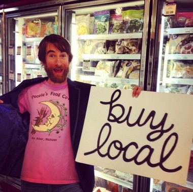 """Ann Arbor musician and organic vegetable farmer Chris Good debuted his """"Buy Local"""" song at the HomeGrown Festival in Ann Arbor. The music video was a collaborative effort between 14 local musicians and more than 40 businesses and organizations."""