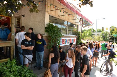 Dozens of people waited in line outside of Blimpy Burger in August 2013, the day before the restaurant closed on South Division Street.
