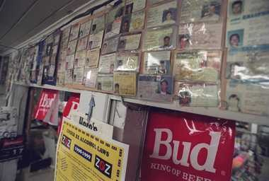The wall of shame at the Blue Front Kegs Party Store on State Street and Packard in Ann Arbor.