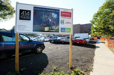 A sign on the 414 N. Main site advertises the soon-to-come luxury condominiums on the site of the former Greek Church building.