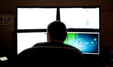 An employee works on a screen at Barracuda Networks in downtown Ann Arbor in 2013.