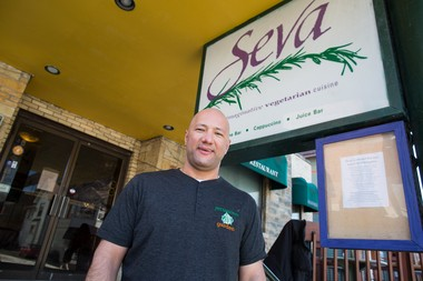 Jerusalem Garden owner Ali Ramlawi stands outside the former Seva building in downtown Ann Arbor, where he'll be re-opening his restaurant on Wednesday, April 29.