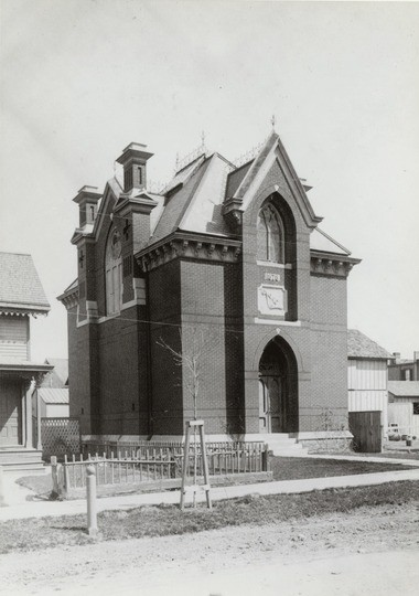 A historic photo of the Shant shows the building before 1901, when the brick wall was constructed to keep people off the property.