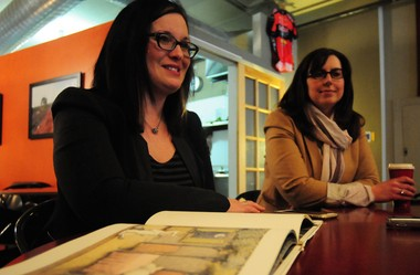Christina York and Marjorie Knepp, explain how they have been developing their product, Magic Book, at Mighty Good Coffee, Wednesday, January 14, 2015. Nicole Hester | The Ann Arbor News