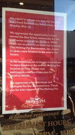 A sign hung on the front door to The Melting Pot in Ann Arbor informing customers of the closure.
