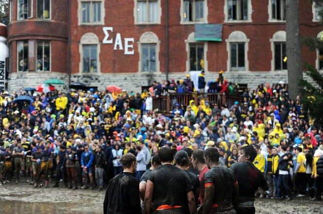 Spectators filled all four sides of the muddy field outside the Sigma Alpha Epsilon house for the Mud Bowl Oct. 19. Brianne Bowen | The Ann Arbor News