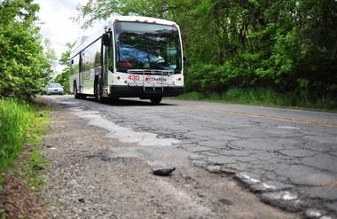 An AAATA bus rolls down Pontiac Trail in Ann Arbor on Thursday.