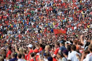 Fans fly a Manchester United during an exhibition game for the International Champions Cup at Michigan Stadium on Saturday, August 3, 2014. Melanie Maxwell | The Ann Arbor News