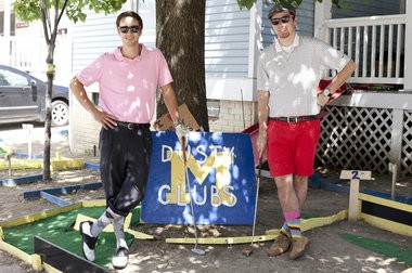 Kevin McDonald, left, and roommate Jordan Hammock pose for a photograph at Dusty Clubs Mini-Golf in Ann Arbor on Thursday, Aug. 14, 2014. McDonald and Hammock made the mini-golf course in their front yard. Patrick Record | The Ann Arbor News