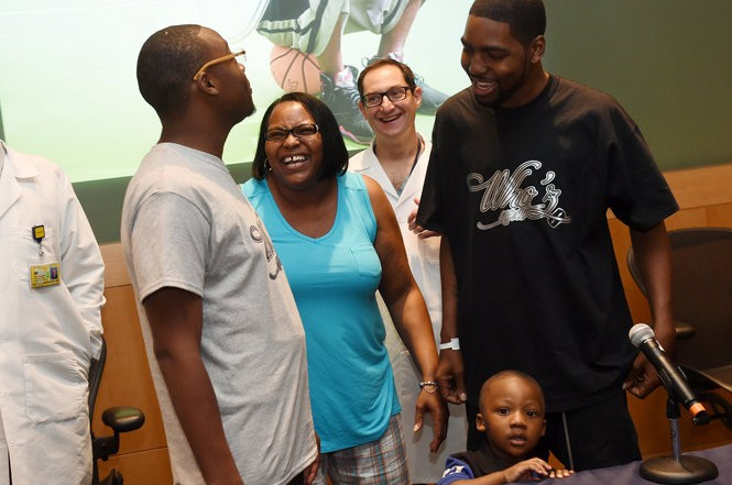Voncile McCrae, center, laughs with her sons Dominique and Stan Larkin following a talk at the Michigan Frankel Cardiovascular Center on Thursday, May 26, 2016. Both Larkin brothers were born with a form of cardiomyopathy and have both received heart transplants. Melanie Maxwell   The Ann Arbor News