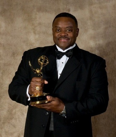 Jesse McGuire holding the NATAS Emmy Award that he won back in 2009 for Best On-Camera Talent -Â Performer/Narrator.