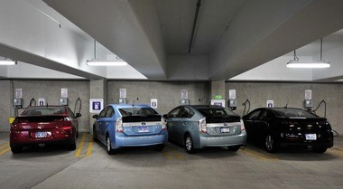 A row of four plug-in vehicles â two Volts and two Priuses â charge inside the Library Lane underground parking garage in Ann Arbor.