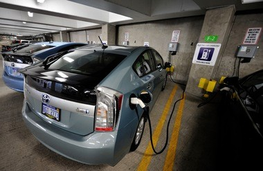A plug-in hybrid Prius charges inside the Library Lane underground parking garage in Ann Arbor.