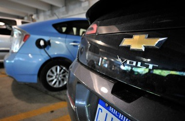A Chevy Volt waits for a Prius to finish charging inside the Forest Avenue parking garage in Ann Arbor.