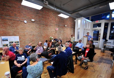 Residents gather Thursday night at the Workantile on Main Street to discuss downtown zoning changes.