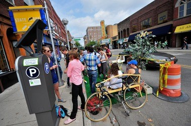 People gather in a temporary mini park on State Street on Friday as part of PARK(ing) Day.