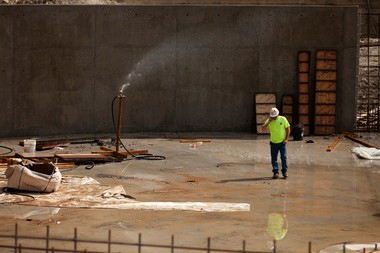 A construction worker talks on the phone at the Ann Arbor Wastewater Treatment Plant on Dixboro Road on Wednesday, Sept. 25. The west plant is currently being rebuilt.