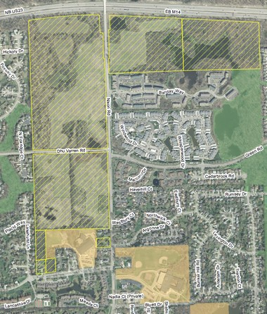 The shaded yellow properties represent sites along Nixon Road in Ann Arbor that are slated for development, with the North Oaks sites on the west side of the road and the Woodbury Club site on the east side of the road.
