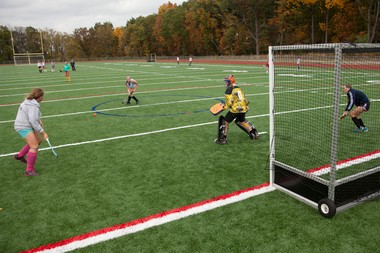 The Skyline High School girls field hockey team practices on the new synthetic turf field on Wednesday, Oct. 16, 2013, in Ann Arbor.
