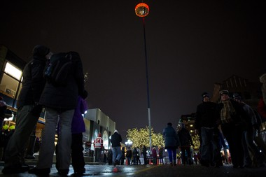 The puck designed by METAL hangs over Main street in Ann Arbor on New Year's Eve, the puck will drop at midnight during the Puck Drops Here party.