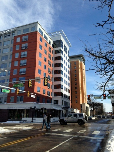 While apartment high-rises like 411 Lofts and The Varsity on Washington Street have catered to a student population, experts say more dense housing in downtown Ann Arbor could attract more young professionals.
