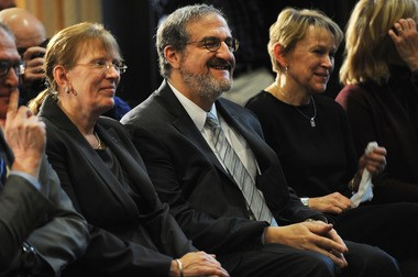 Brown University Provost Mark Schlissel, center, sits at the Michigan Union Friday, Jan. 24, where the University of Michigan Board of Regents unanimously approved hiring him as the 14th president of U-M. Schlissel's wife, Monica Schwebs, is on the left.