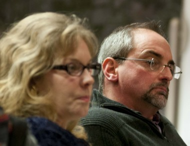 Linda and Mark Smith listen to residents voice their opposition to the proposed development during a public hearing on the project.