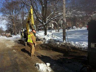 Workers repair a water main break on Baldwin Avenue in Ann Arbor in negative temperatures on Jan. 7.