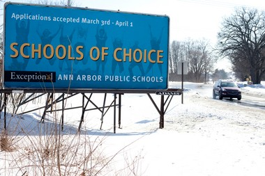 One of three billboards Ann Arbor Public Schools has paid for to advertise for its School of Choice campaign this February and March. This billboard, seen Feb. 19, is located on Baker Road near Newman Boulevard in Dexter.