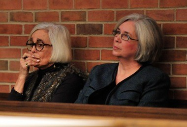 Library Director Josie Parker, right, and library board member Jan Barney Newman listen to a discussion of the future of the Library Lot, the city-owned parking lot next to the downtown library, at last week's City Council meeting.
