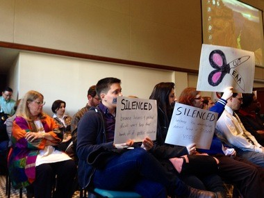 Protesters against EMU's involvement in the EAA attended the school's Board of Regents meeting on March 25, 2014.