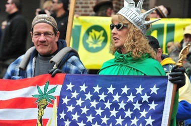 A woman dressed as Lady Liberty holds a pro-pot flag on the Diag during Hash Bash in 2011.