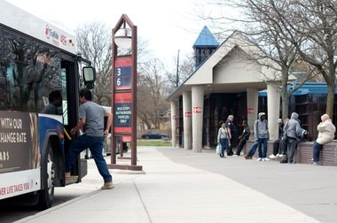 A passenger boards a bus at the Ypsilanti Transit Center on Thursday.