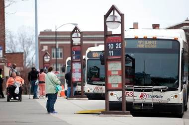 Passengers wait for their buses at the Ypsilanti Transit Center on Thursday.