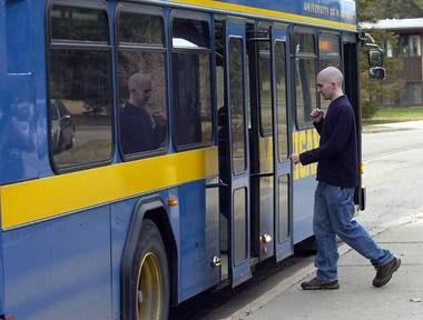 A University of Michigan senior catches the bus to central campus in this file photo.