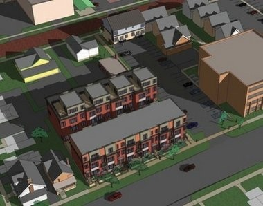 An overhead view of the Kerrytown condo project shows the two larger buildings with a shared courtyard in the middle and the smaller Fourth Avenue building to the east. The project is surrounded by residential and commercial uses.