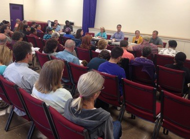 Dozens of residents packed into the Ann Arbor Community Center for Saturday's forum.
