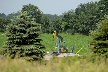 An oil pump jack located on a farm on Braun Rd. in Saline Township, approximately 20 miles south of proposed drilling in Scio Township.