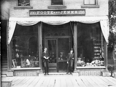 Pharmacists Charles E. Foote and Charles C. Jenks, pictured here, opened this drug store at 216 W. Michigan Ave. on April 4, 1884. Based on their inventions, the company soon grew into Foote & Jenks, a major manufacturer of food flavorings.