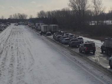 Traffic backed up on U.S. 23 on Friday January 9, 2015 after several semis jackknifed and a massive pileup occurred. Nicole Hester | The Ann Arbor News