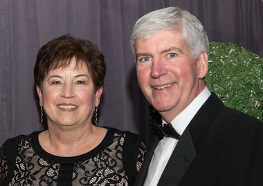 Rick and Sue Snyder pose for a photo during a charity event in 2014.