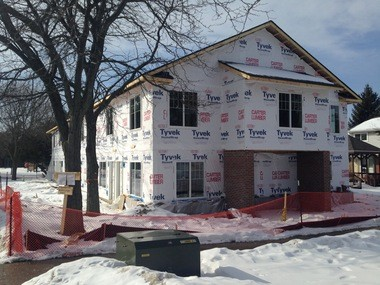A new apartment building takes shape at Green Baxter Court, a Housing Commission property on Green Road, replacing a building that was badly damaged in a fire in January 2014.