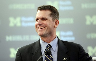 Jim Harbaugh, Michigan's new head football coach, addresses the media after after he was introduced during an NCAA college football news conference Tuesday, Dec. 30, 2014, in Ann Arbor, Mich.