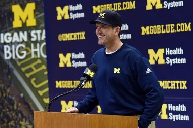 Michigan head football coach Jim Harbaugh provided first aid along with Jim Minick after a crash on I-94 Tuesday.