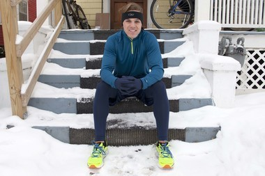 Barclay Oudersluys sits on the porch of his home in Ann Arbor before training on a winter day. Oudersluys plans to run across the country for Project Gump, a tribute to his favorite movie Forrest Gump, and to raise $10,000 for Sara and Ryan Hall's Steps Foundation this summer.