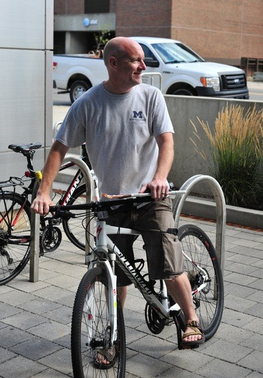 Kevin Leeser heads out on his bicycle after leaving the city clerk's office on Wednesday, Aug. 5, 2015. He had just submitted 102 signatures, two more than were required, and went out to get more just in case some of the initial signatures were deemed invalid. He ended up with 104 in the end, which means no more than four can be deemed invalid for him to be eligible to run in the 5th Ward in November.